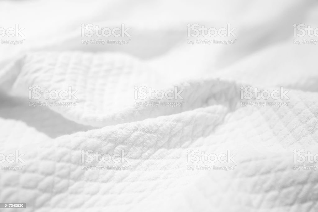 White cotton fabric texture, crumpled blanket stock photo