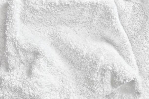 white cotton towel terry cloth texture - sauna textilien stock-fotos und bilder