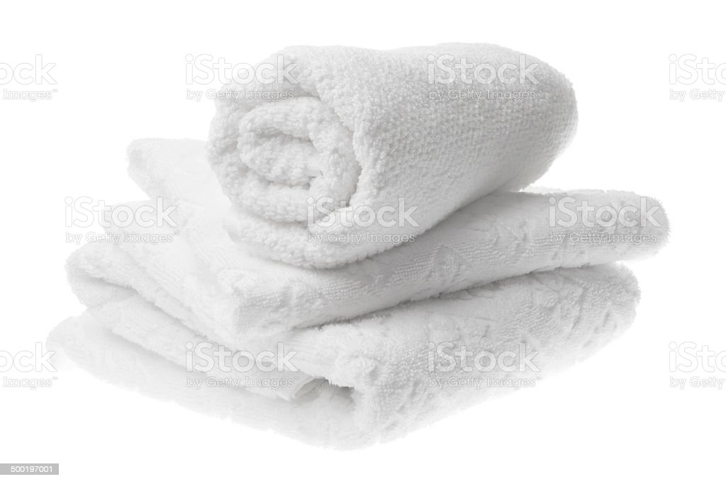 White cotton towels stack isolated stock photo