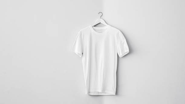 White cotton t-shirt on hanger White cotton t-shirt on hanger coathanger stock pictures, royalty-free photos & images
