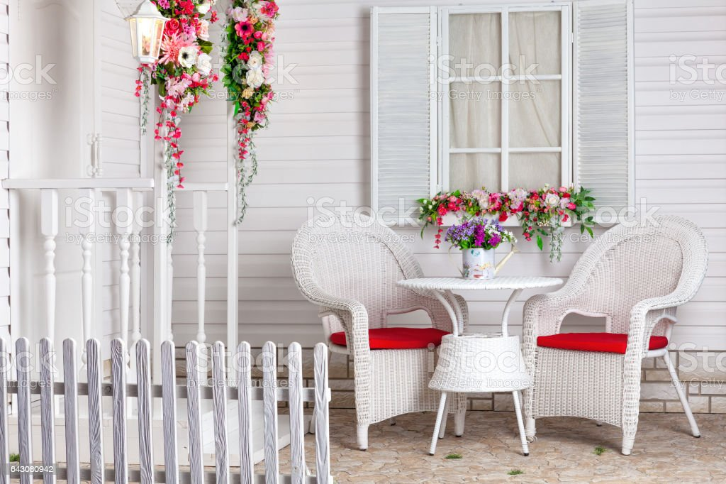 White country house in Provence style decorated with flowers. stock photo