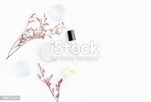 927626522 istock photo White cream bottle placed and flowers, Blank label package for mock up on a white background. The concept of natural beauty products. 836213472