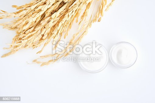 927626522 istock photo White cream bottle placed and rice, Blank label package for mock up on a white background. The concept of natural beauty products. 836215668