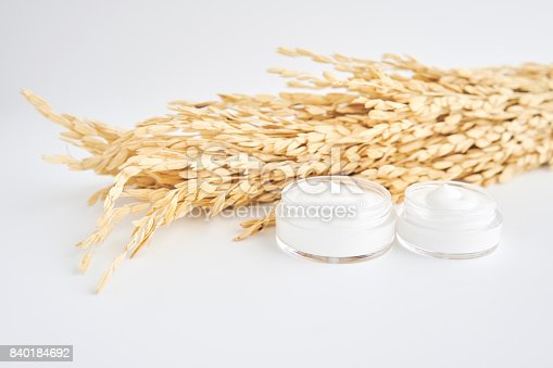 927626522 istock photo White cream bottle placed and rice, Blank label package for mock up on a white background. The concept of natural beauty products. 840184692