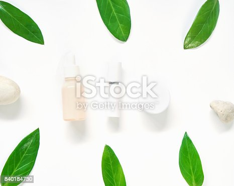927626522 istock photo White cream bottle placed, Blank label package for mock up on a green foliage background and flowers. The concept of natural beauty products. 840184730