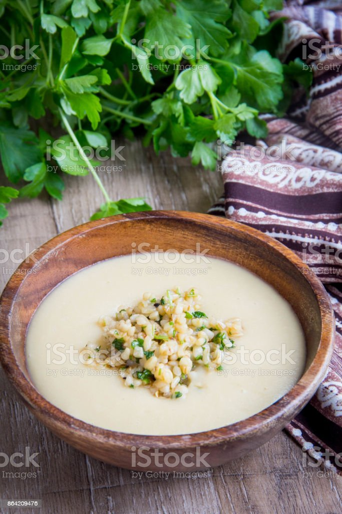 White cream soup with vegetables, mushrooms, rice, bulgur, tasty light first course royalty-free stock photo