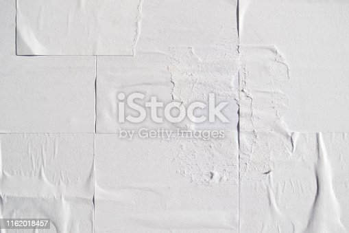 istock White creased poster texture. Abstract background. 1162018457