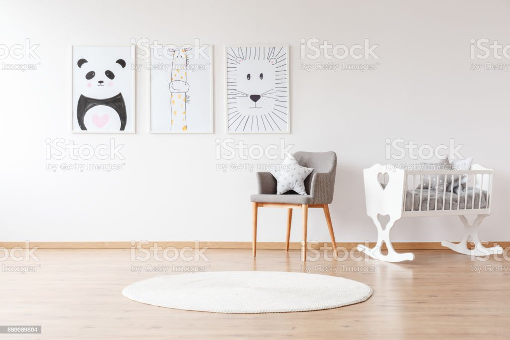 White crib in baby's room stock photo