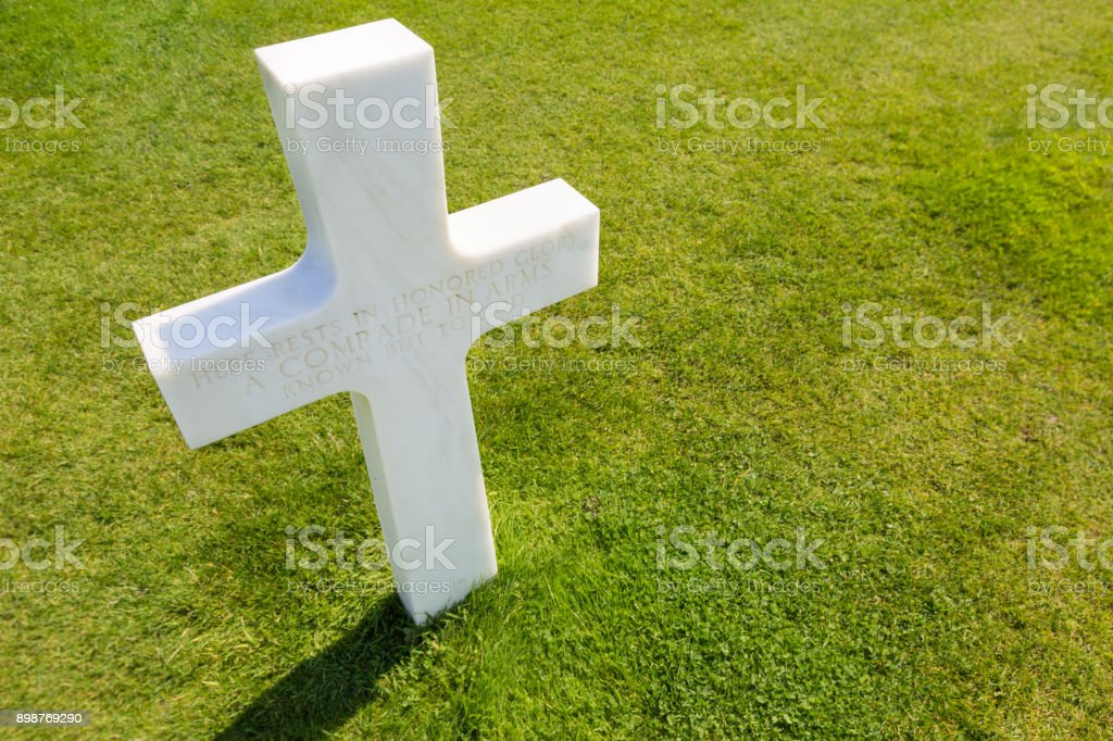 White cross for an unknown soldier at american cemetery in Colleville-sur-mer, Normandie, France stock photo