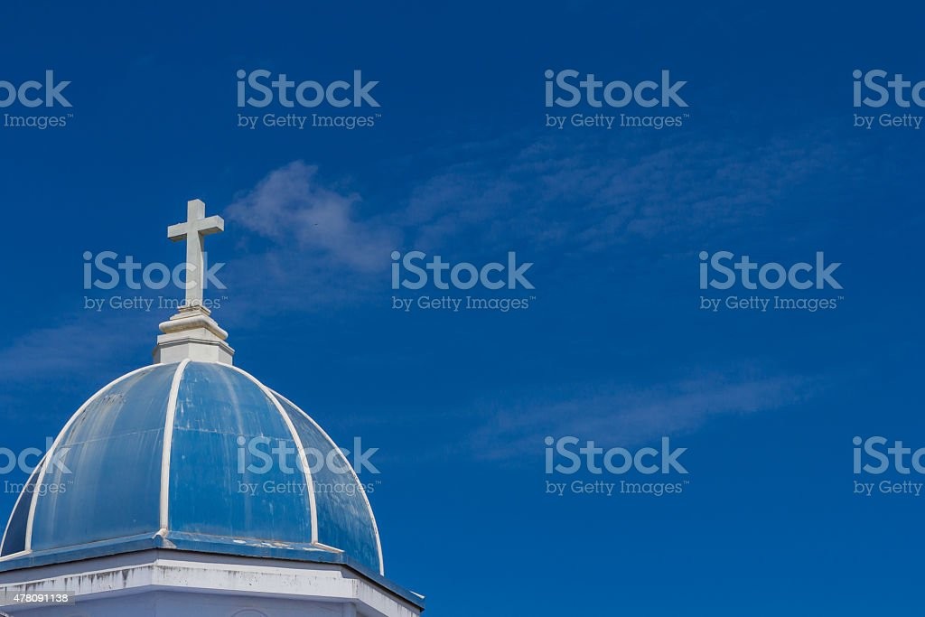 white cross on blue sky stock photo