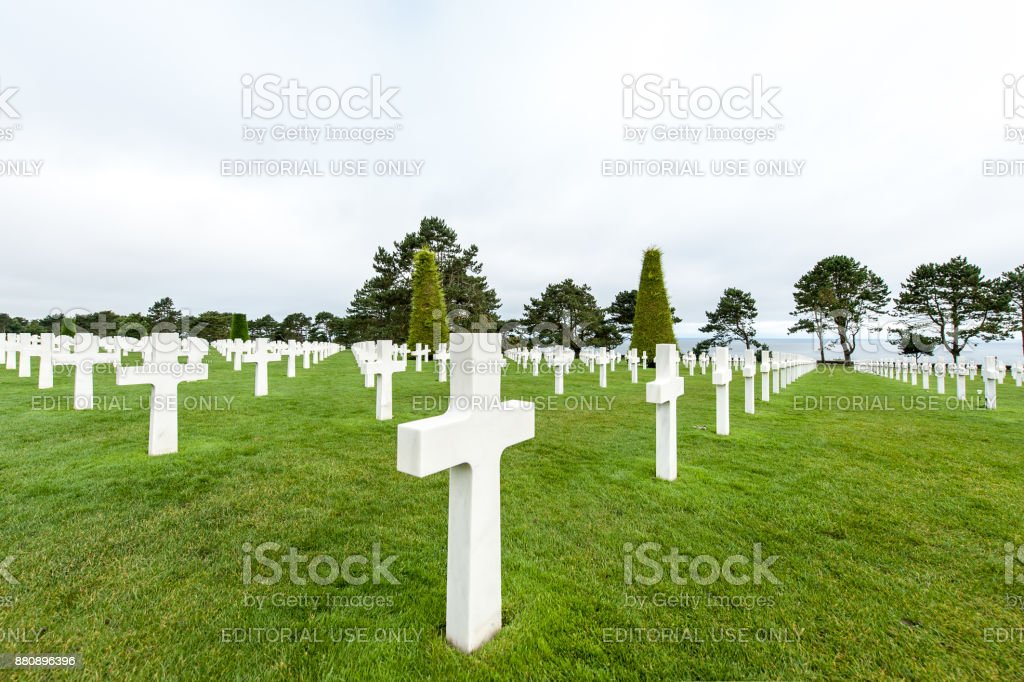 White crosses mark the graves of service men at the Normandy American Cemetery stock photo
