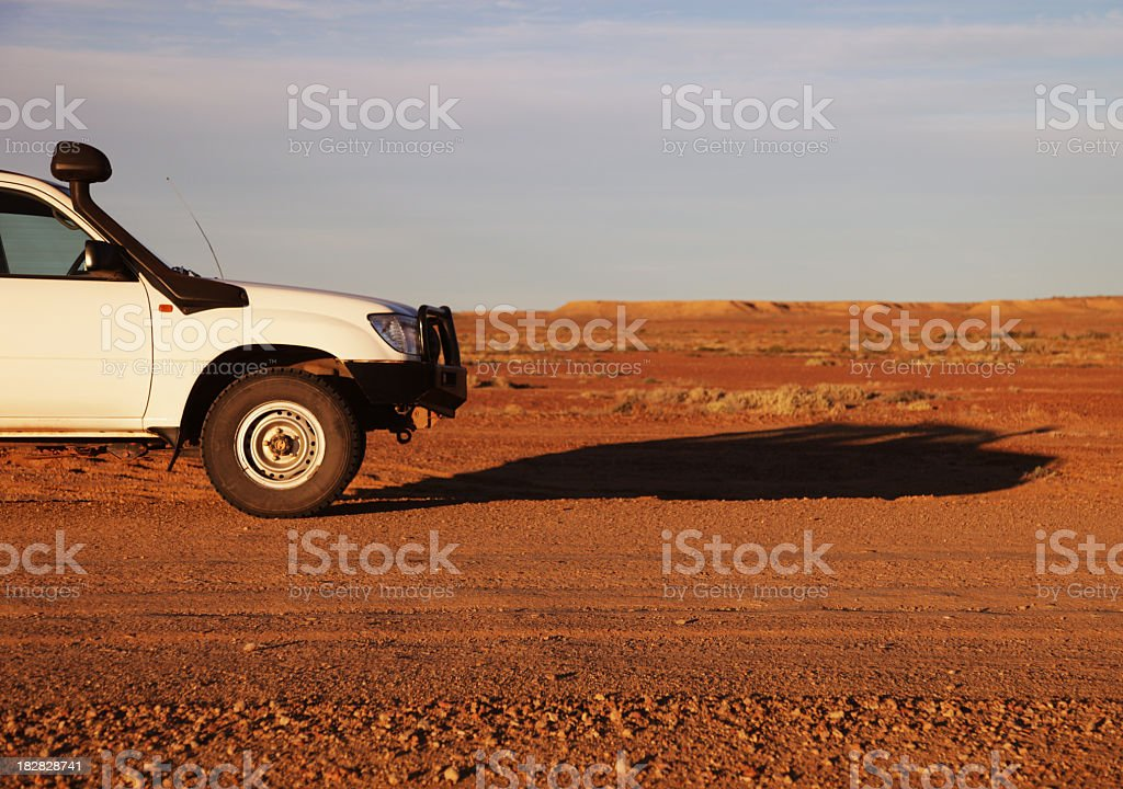 A white cruiser with a front guard in an open dry land royalty-free stock photo