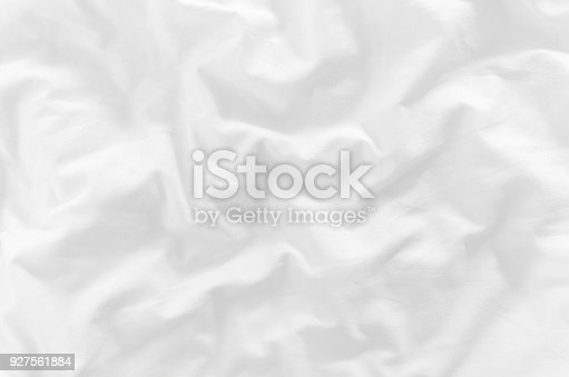 white crumpled bed sheet closeup top view