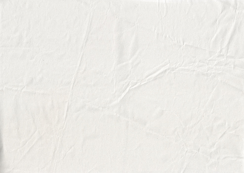 texture of white crumpled kraft paper sheet with small soft brown grain dust