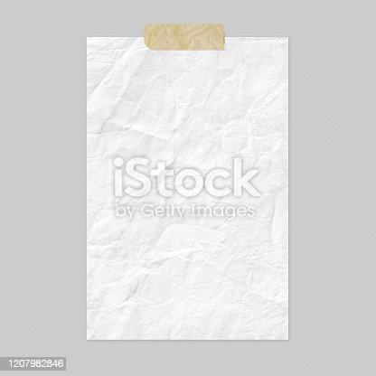 istock White crumpled paper sheet on light gray background 1207982846