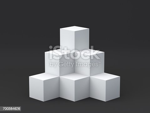 697820188 istock photo White cube boxes on dark background for display. 3D rendering. 700584626