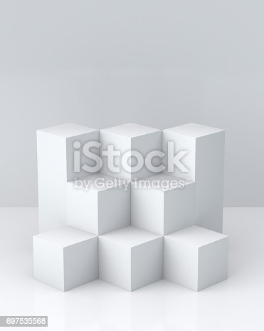 697820188 istock photo White cube boxes with white blank wall background for display. 3D rendering. 697535568