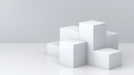 istock White cube boxes with white blank wall background for display. 3D rendering. 697820188