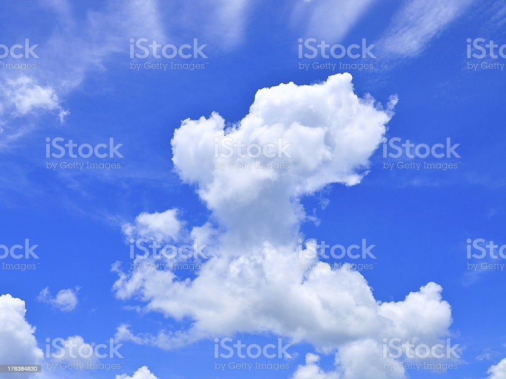 White cumulus clouds and a blue sky royalty-free stock photo
