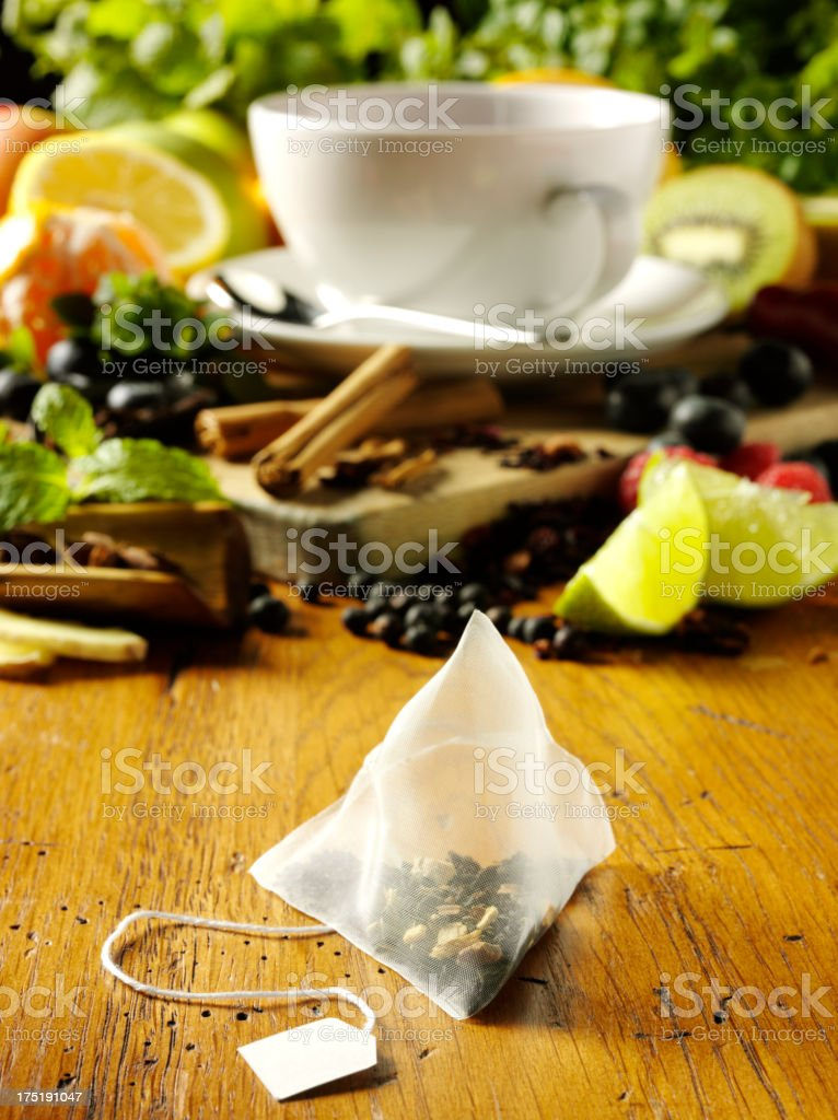 White Cup and Fresh Fruits with a Tea Bag royalty-free stock photo