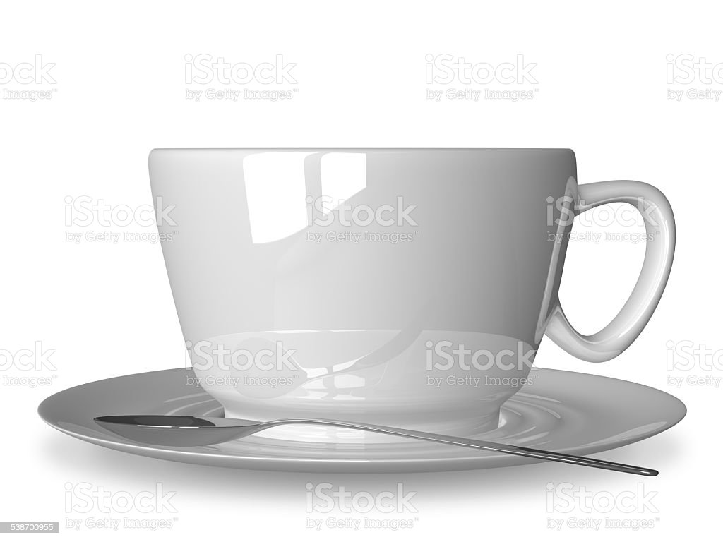 White cup and spoon on saucer stock photo