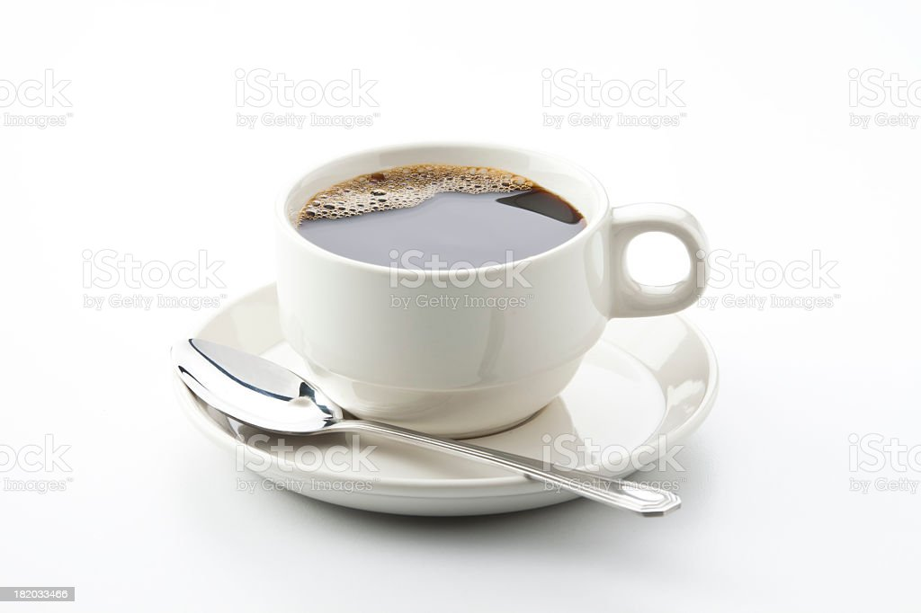 White cup full of black coffee with a spoon stock photo