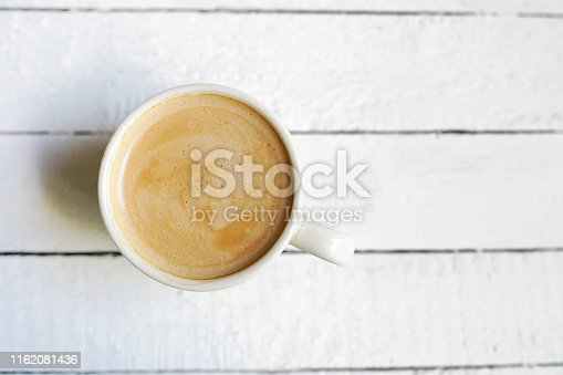 White cup of coffe , Copy Space on white wooden background