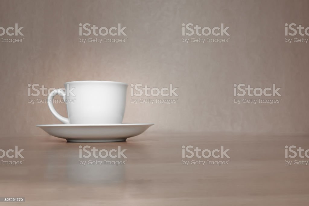 A white cup of coffee in vintage background. stock photo