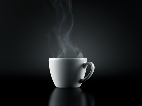 White Cup of Coffee isolated on Black Background