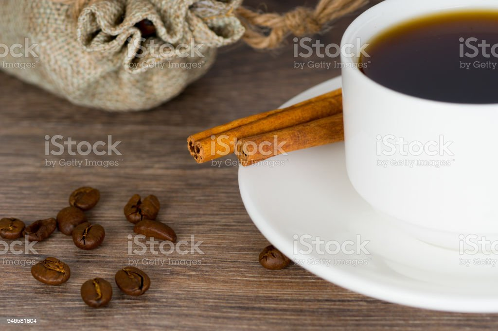 white cup of coffee, jute bag with organic coffee beans stock photo