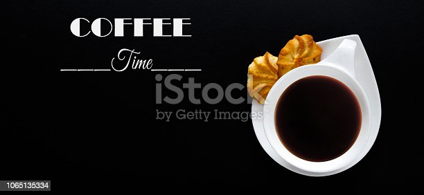 1009835562 istock photo White cup of coffee on a black background with the text