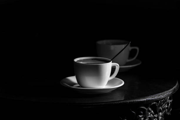White cup of coffee on black background stock photo
