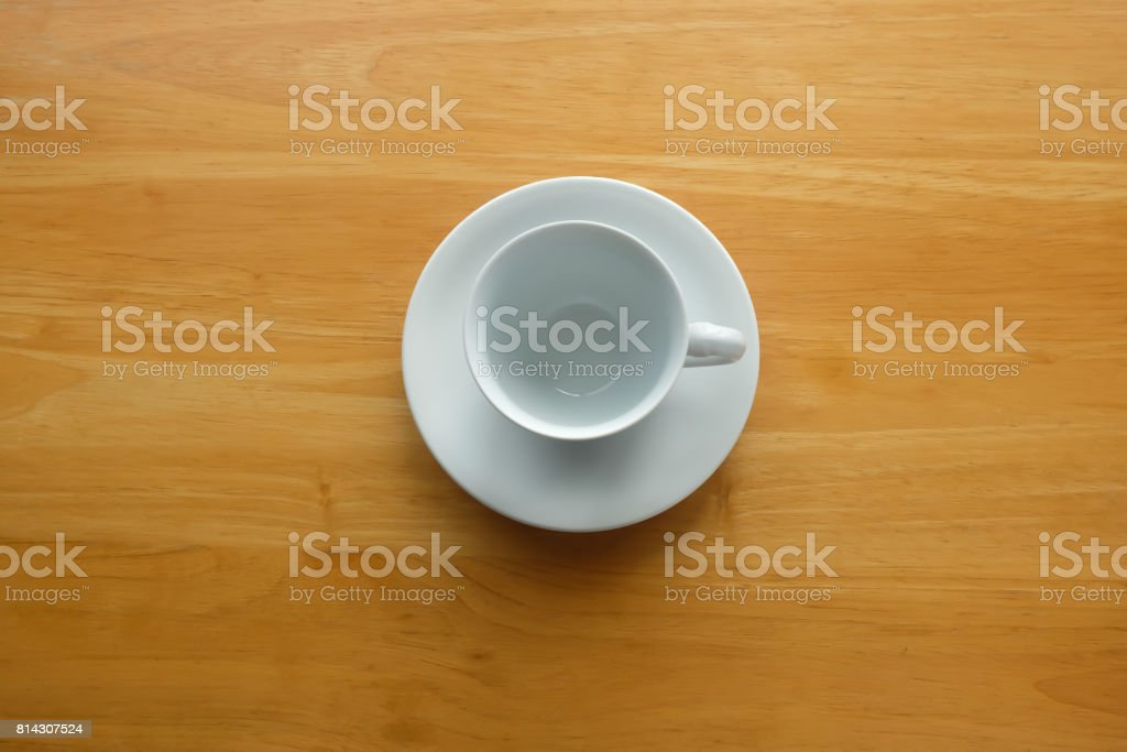 A white cup of coffee on vintage wood table. stock photo
