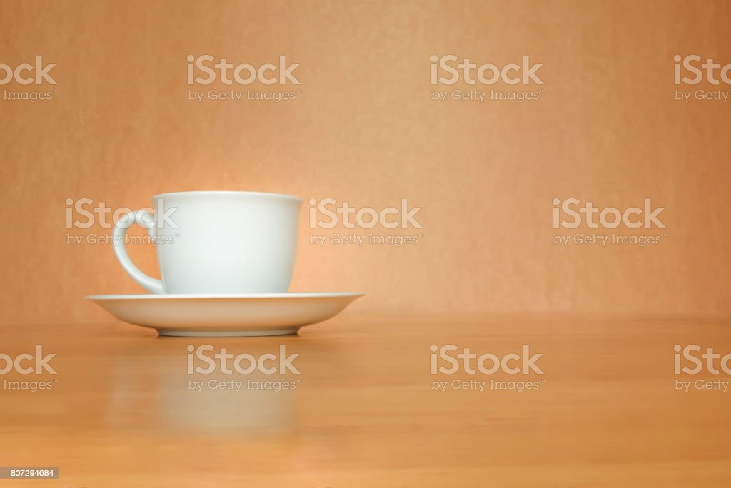 A white cup of coffee on wood background. stock photo