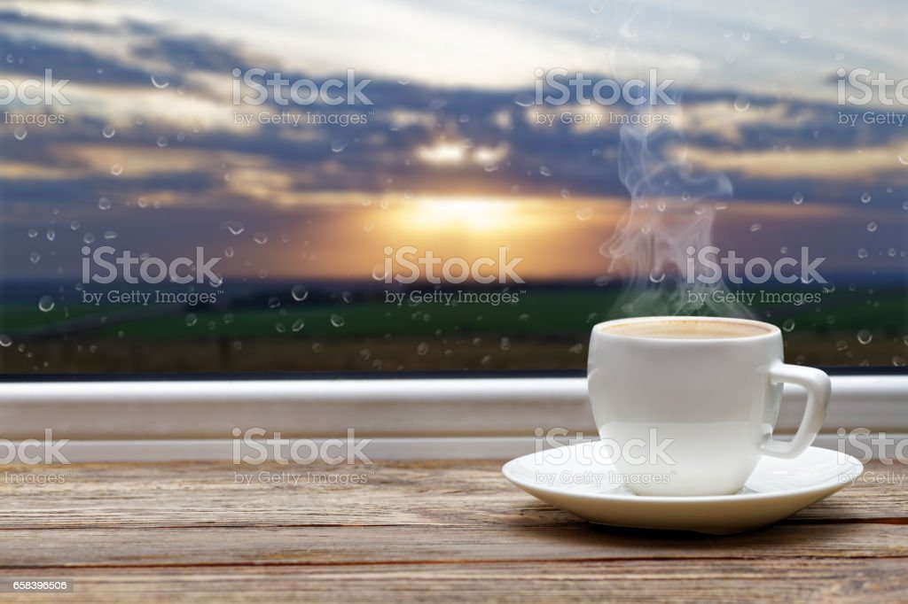 White cup of coffee on wooden windowsill – Foto