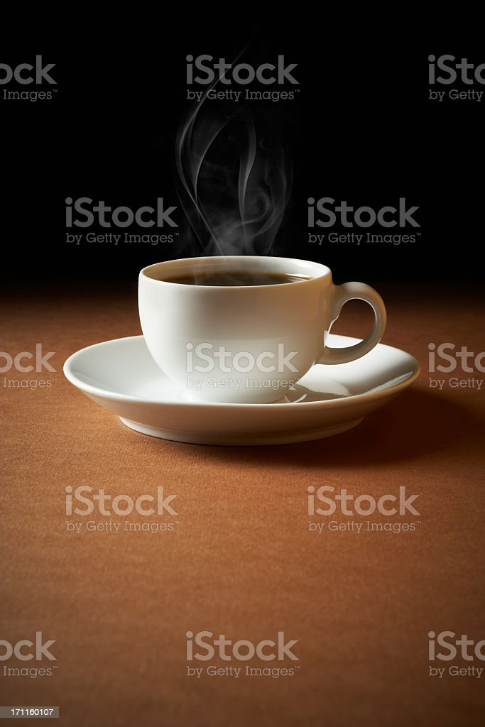 White cup of coffee sends up steam royalty-free stock photo