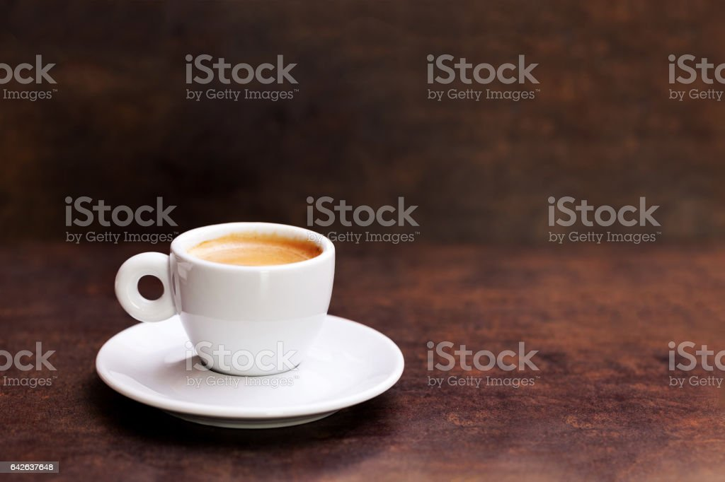 White cup of espresso coffee on background stock photo