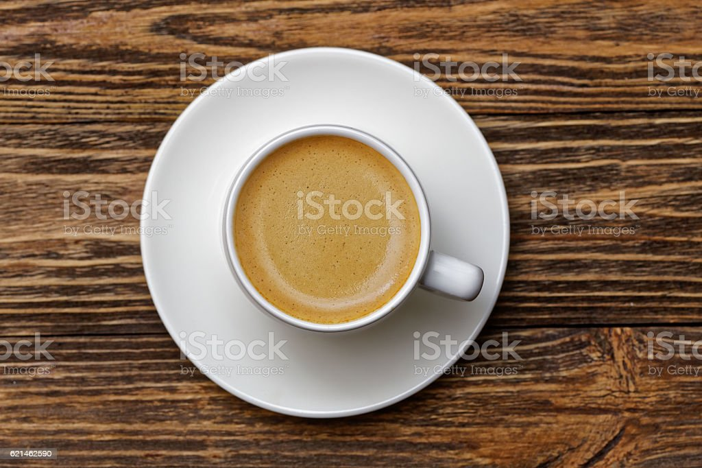 White cup of espresso on wooden table – Foto