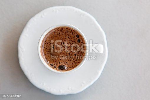 White cup of espresso
