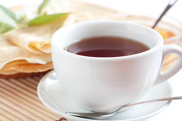 White cup of fragrant tea stock photo
