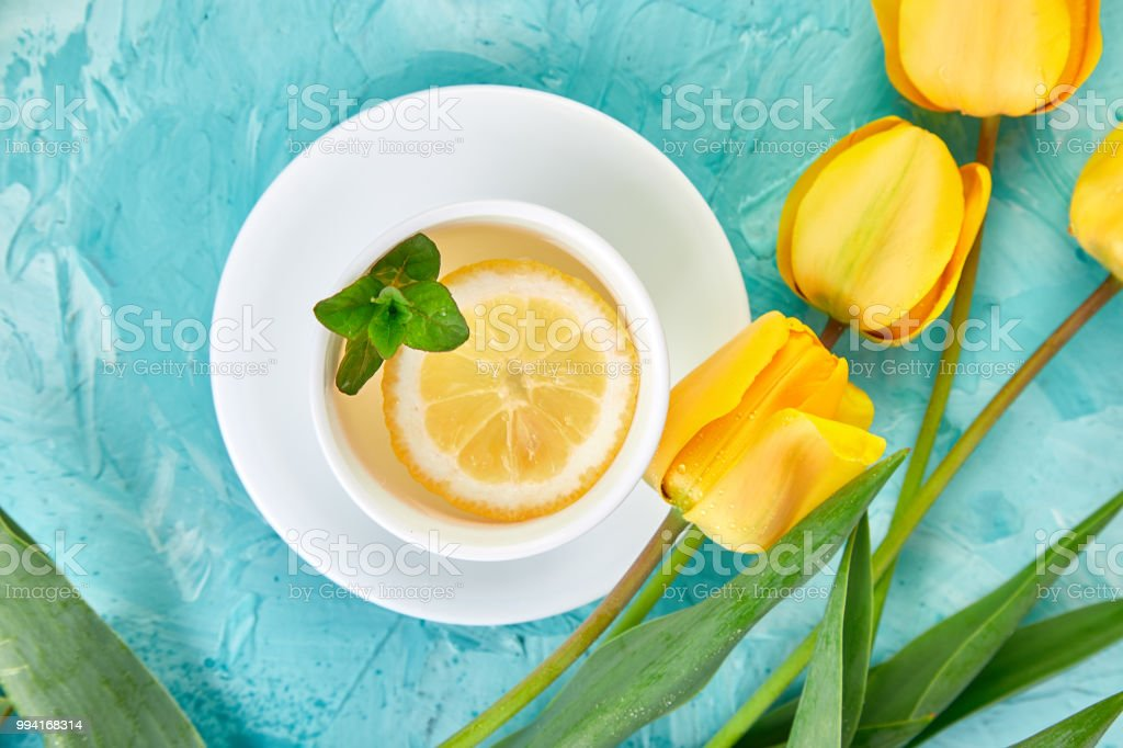 White cup of tea with lemon stock photo
