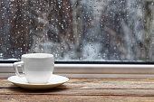 istock White cup on wooden windowsill 621462500