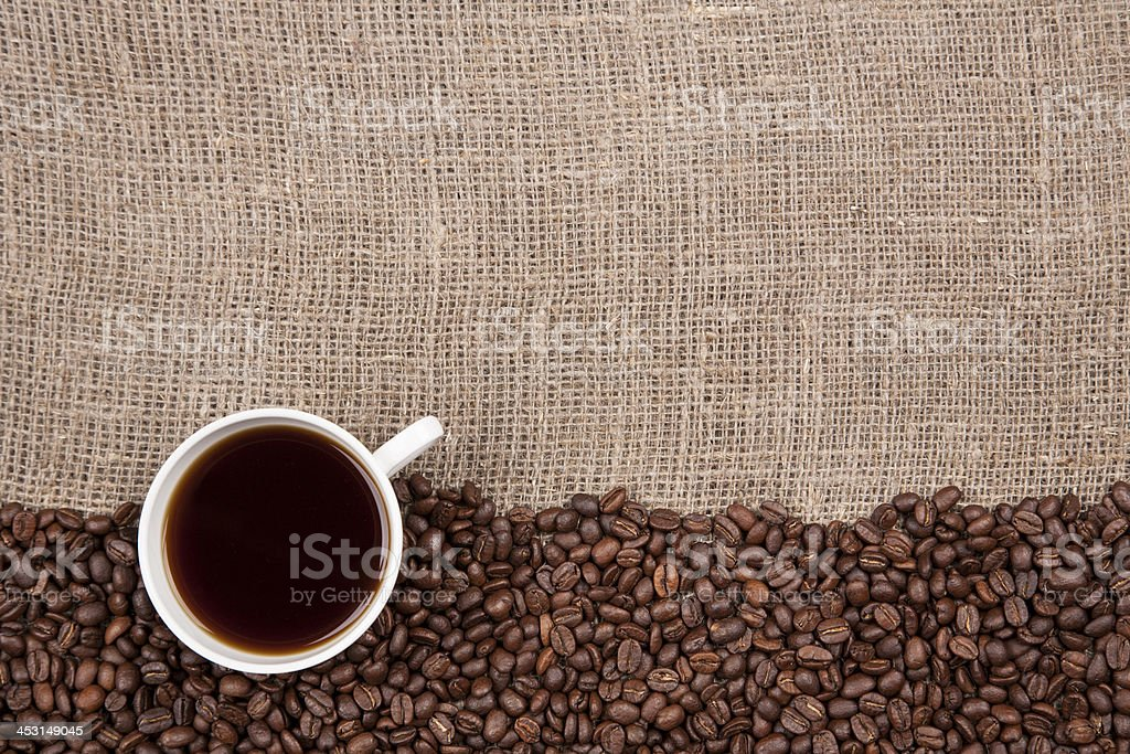 White cup with coffee on burlap royalty-free stock photo