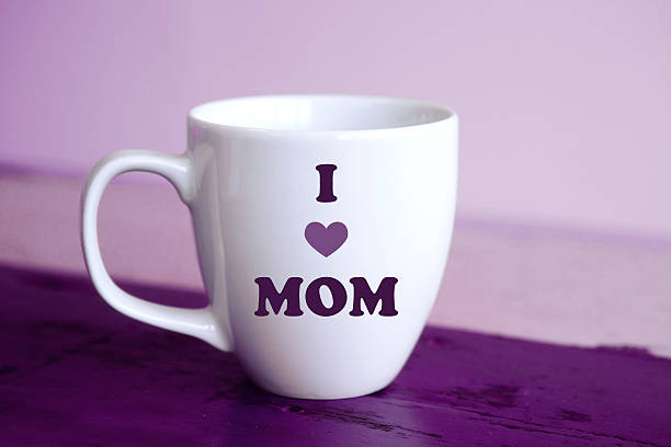 white cup with the words i love mom - happy mothers day type stock photos and pictures