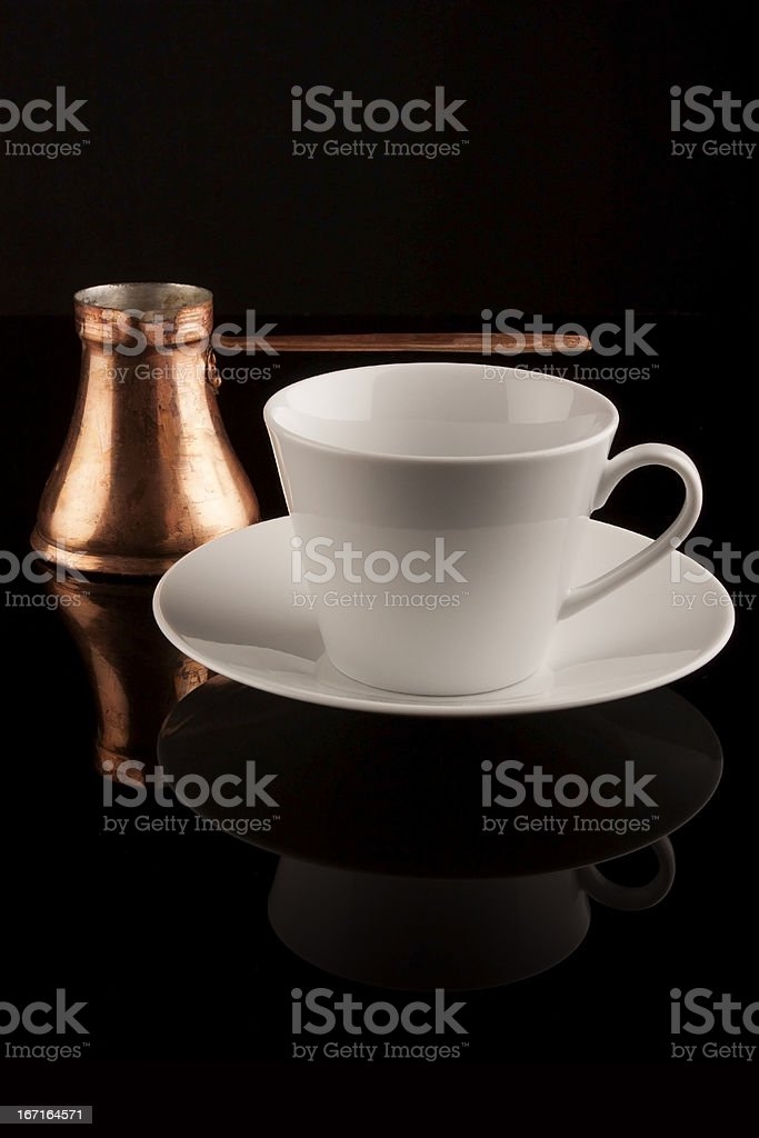 White cup with turkish coffee pot on black reflective surface royalty-free stock photo