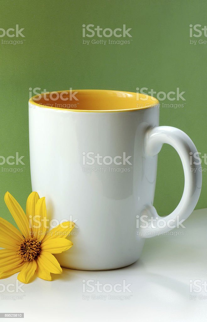 white cup & yellow flower royalty-free stock photo
