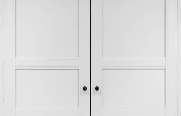 weiße schranktüren mit noppen - geschlossene küchen stock-fotos und bilder