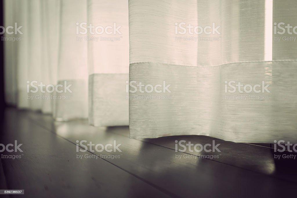 White curtain beside window royalty-free stock photo