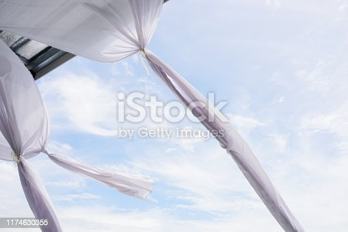 istock White curtain on the window with blue sky 1174630355