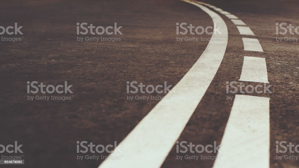 White curved city road marking stock photo